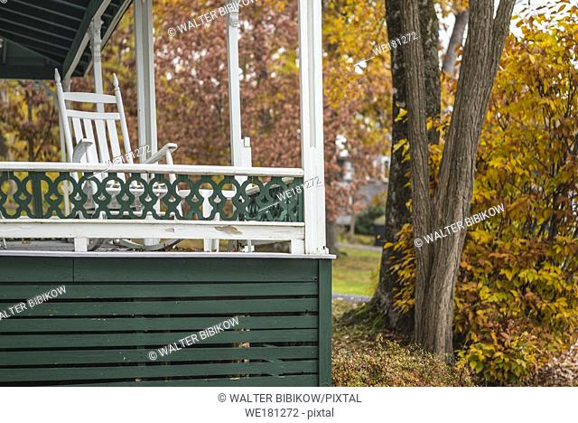 USA, Maine, Bayside, Bayview Cottages, oceanside community of cottages at former religious themed resort, porch, autumn