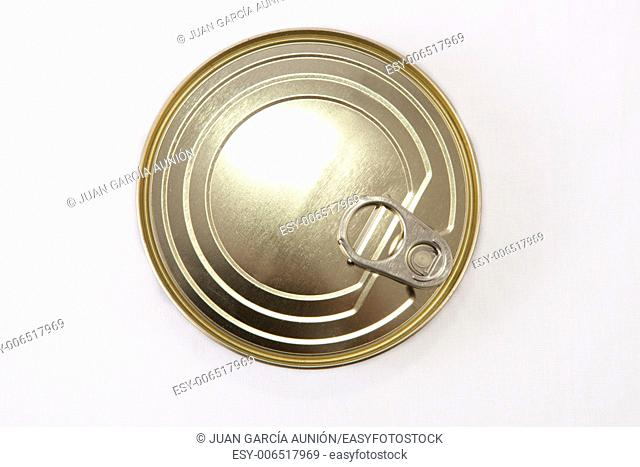 Closed Circular tin can isolated over white background. Selective focus