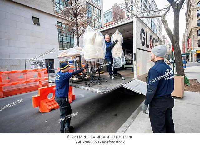 Movers from Globe Moving and Storage transfer mannequins slated for Parsons' famed School of Fashion into the new University Center building of the New School...
