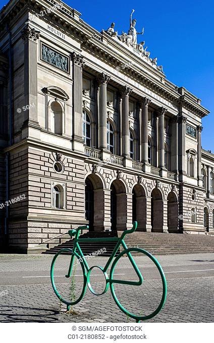 Green bike and Palais Universitaire University building Strasbourg Alsace France
