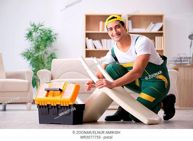 Furniture repairman repairing armchair at home