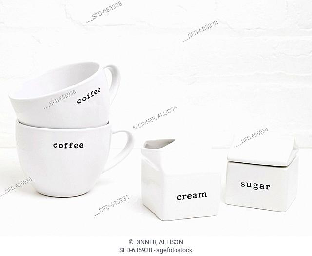 White Coffee Mugs, Cream and Sugar Containers, Labeled
