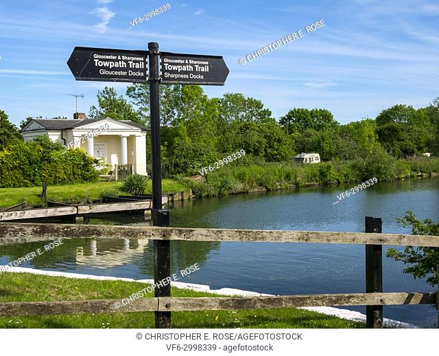 Sign posts for the Towpath Trail at Splatt Bridge and bridge keepers cottage on the Gloucester & Sharpness Canal at Frampton on Severn, Gloucestershire, UK