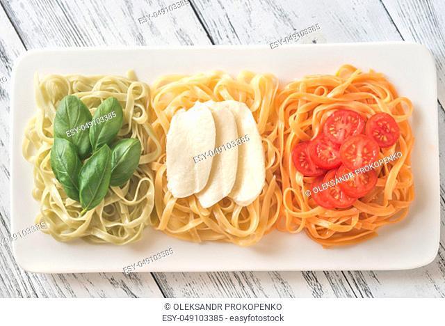 Tagliatelle with basil, mozzarella and cherry tomatoes