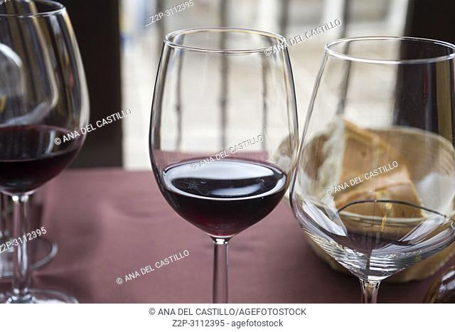 Wineglasses on table of restaurant Spain