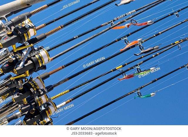 Fishing poles with lures on ocean charter fishing boat, Oregon