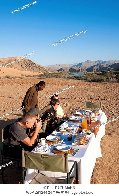 Namibia Africa Northern Desert of Namib Desert border of Angola and Kunene River safari with lunch on river with tent and campers in Hartmann Berge deserted...