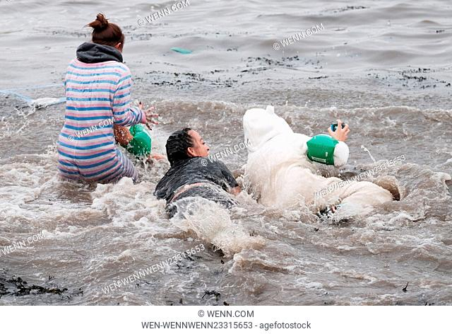Hundreds of Loony Dookers take part in the traditional New Year's Day dip in the River Forth. Featuring: Atmosphere Where: South Queensferry