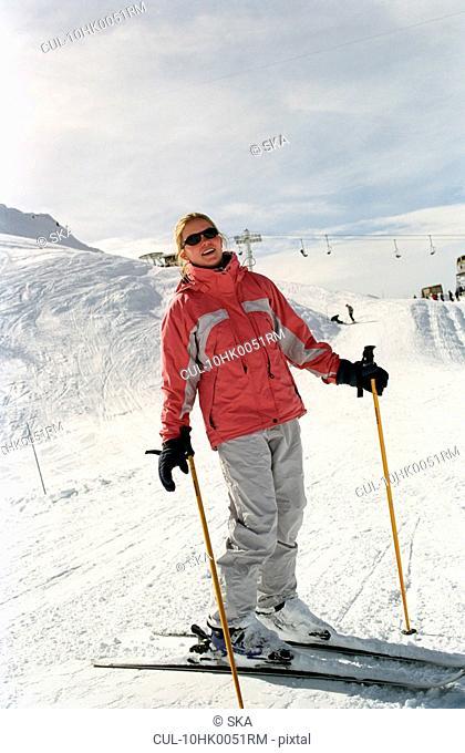 Girl posing on skis