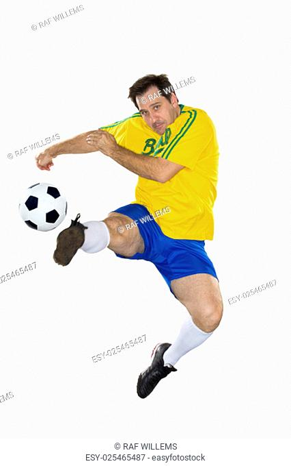 Brazilian Soccer player, jumping, yellow and blue