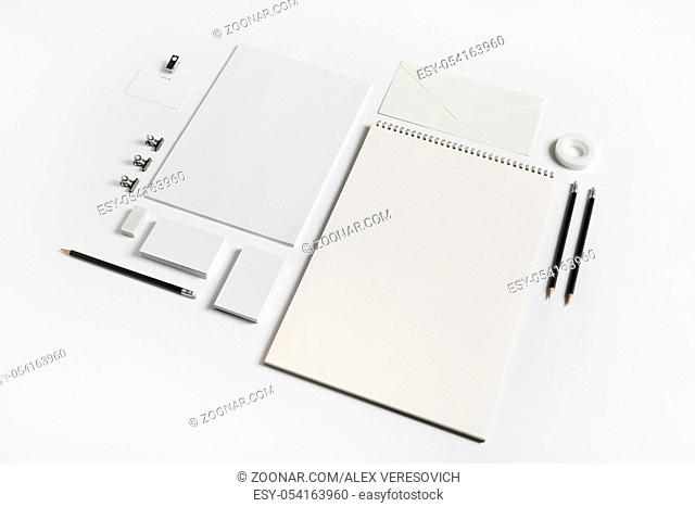 Photo of blank stationery elements on white paper background. Branding template. Mock-up for your design