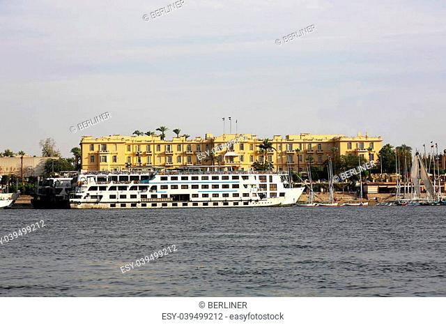 the Old Winter Palace and a Cruise Ship at the east bank in Luxor, Egypt