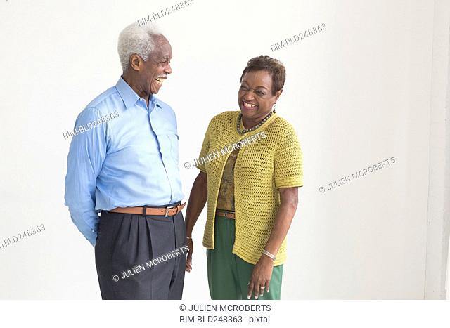Portrait of older Black couple laughing