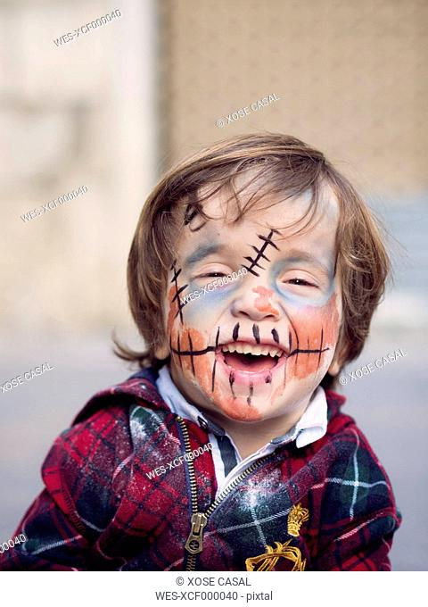 Portrait of smiling little boy with Halloween face painting