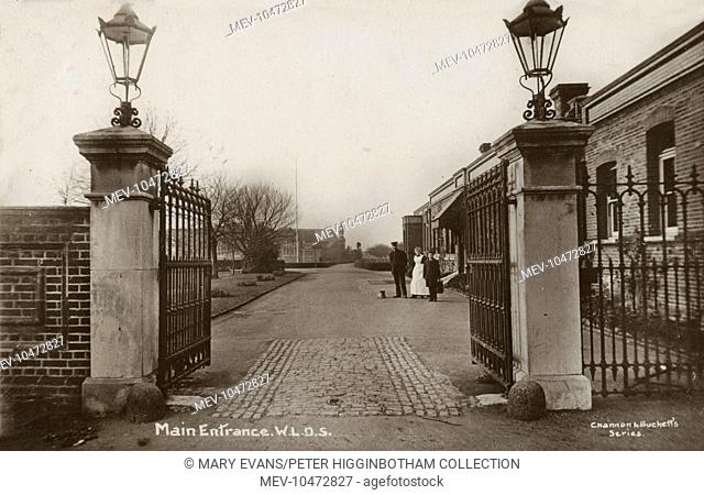 Staff near the entrance to the West London District School on Woodthorpe Road, Ashford, near Staines, Surrey, opened in 1872 as the West London District School...