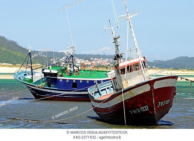 Stranded ships for repair. A Insua inlet, Ponteceso, Galicia, Spain