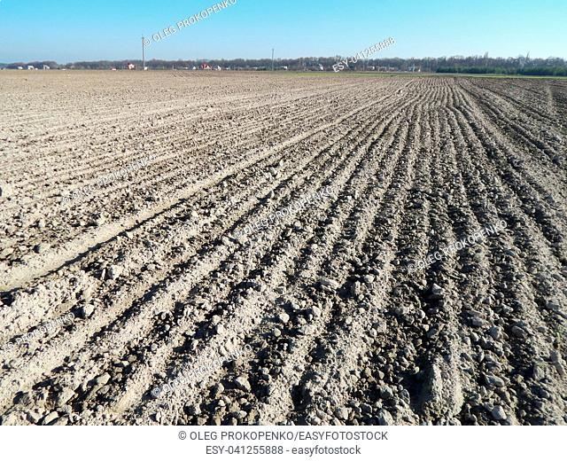 Tractor plowed field and arable land