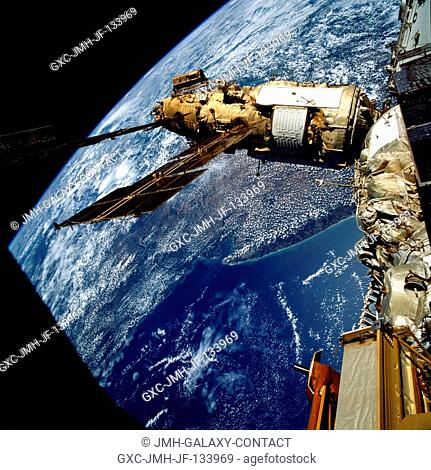 The crew took this 70mm picture of Russia's Mir Space Station over Australia. The crew docked the Space Shuttle Atlantis with the Mir Space Station on March 23