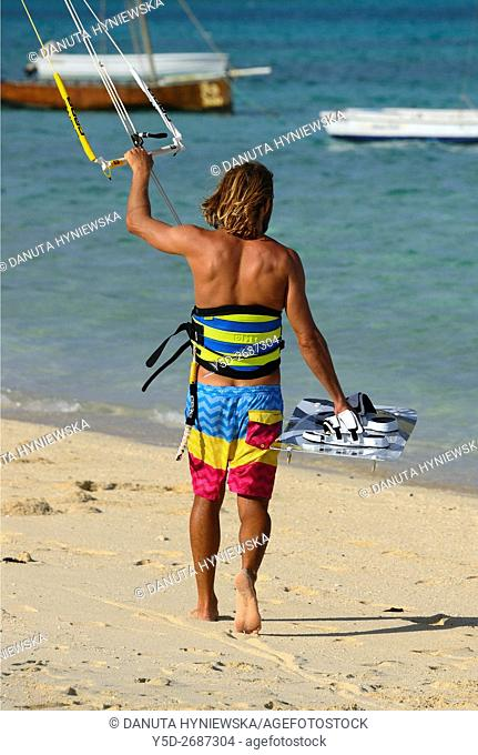 kitesurfer entering water of Indian Ocean, Pointe d'Esny beach, Grand Port District, Southeastern coast of Mauritius, Mascarene, Mascarene Islands , Mascarenhas