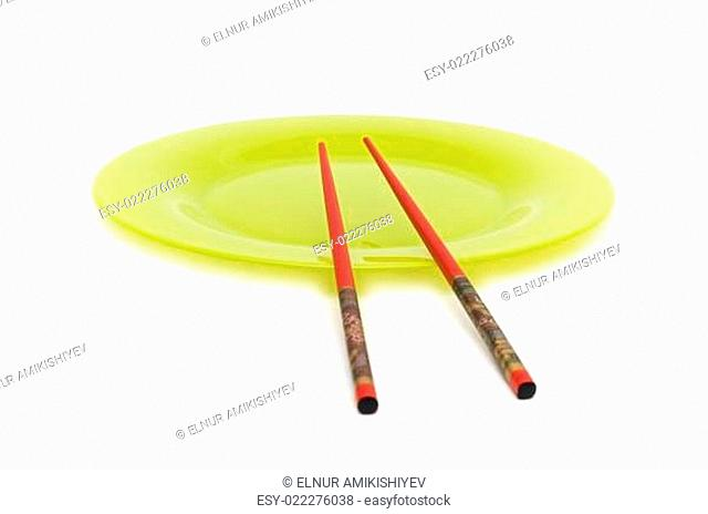 Yellow plate and chopsticks isolated on the white