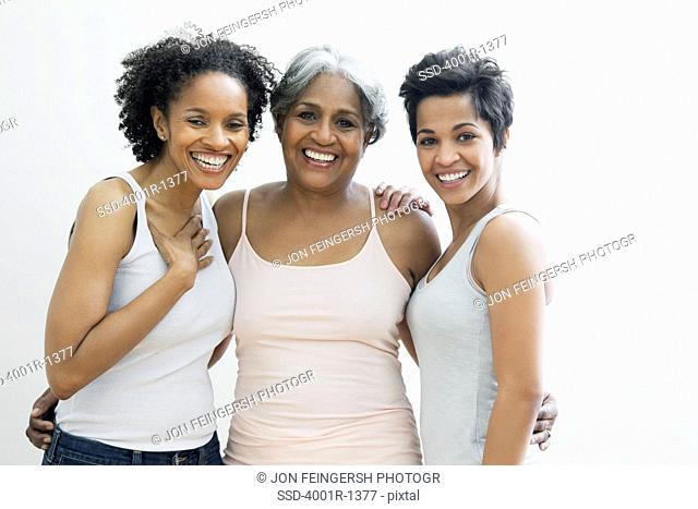 Portrait of a senior woman with her daughters smiling