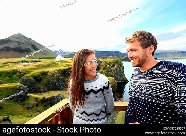 Tourist couple on romantic travel on Iceland. Happy couple sightseeing as tourists visiting landmarks and attractions in Arnarstapi, Snaefellsnes, Iceland