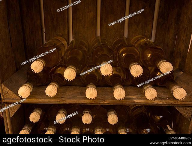 Wine bottles in wine crate, self brewed close-up vintage