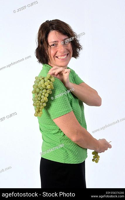 woman with grape in white background