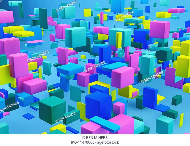 Abstract arrangement of multicolored cubes on blue background