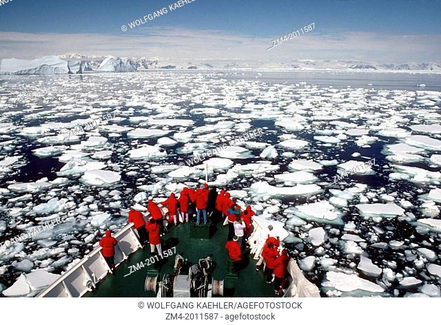 ANTARCTIC PENINSULA AREA, MS EXPLORER GOING THROUGH PACK ICE, WITH PASSENGERS ON BOW