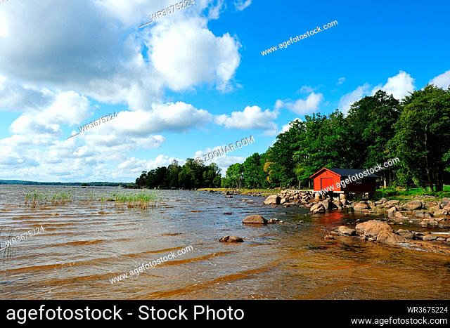 See in Schweden im Herbst. Lake with a boathouse in sweden in autumn