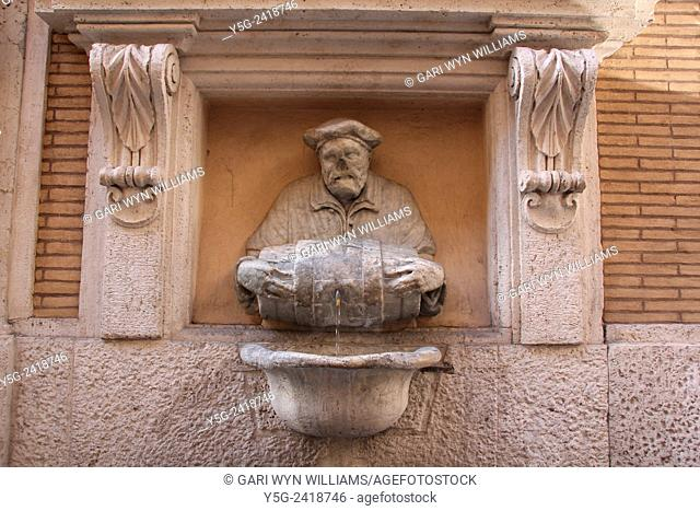 Fontana del Facchino Man holding barrel fountain in street road in rome italy