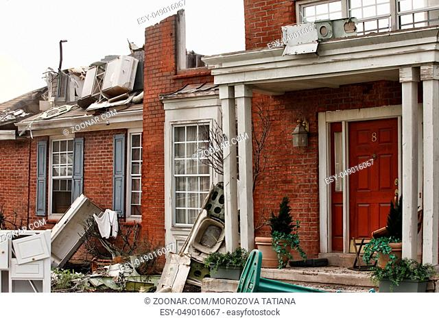 Red brick house, damaged by a natural disaster. Scenery for cinema