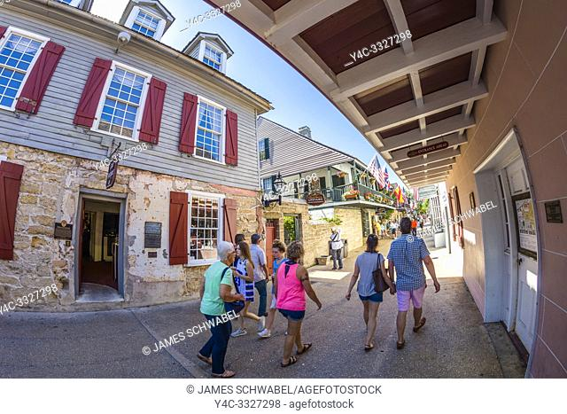 Tourists on historic St George Street in downtown St Augustine Florida Americas oldest city