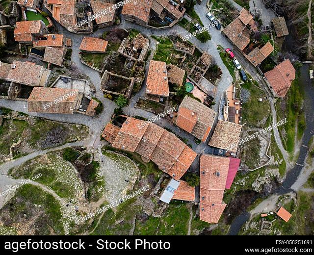 Aerial view of the antique and touristic village of Patones de Arriba, Madrid, Spain. Slate stone architecture