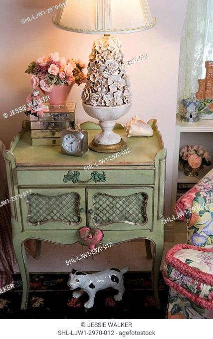 BEDROOM: Cottage style detail, painted green french provincial bedside table with Italian ceramic floral lamp, mirrored box, vased pink roses, birds eye view
