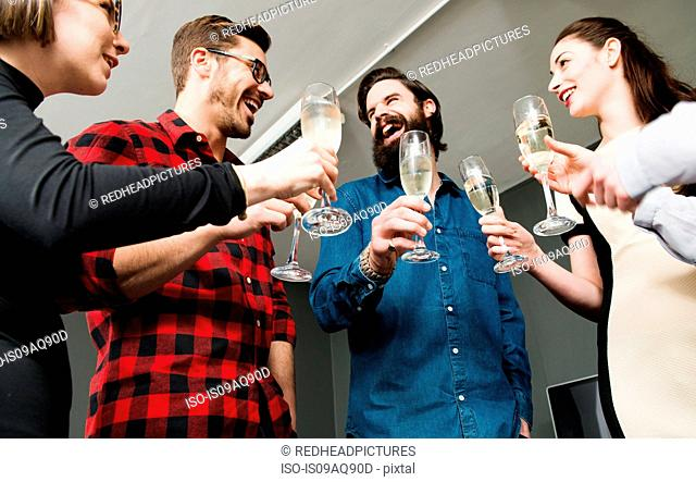 Colleagues toasting with champagne