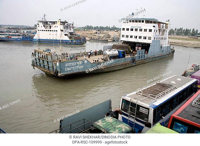Big motor boat small ship being used to cross the buses over Padma River ; waterway transportation ; Bangladesh