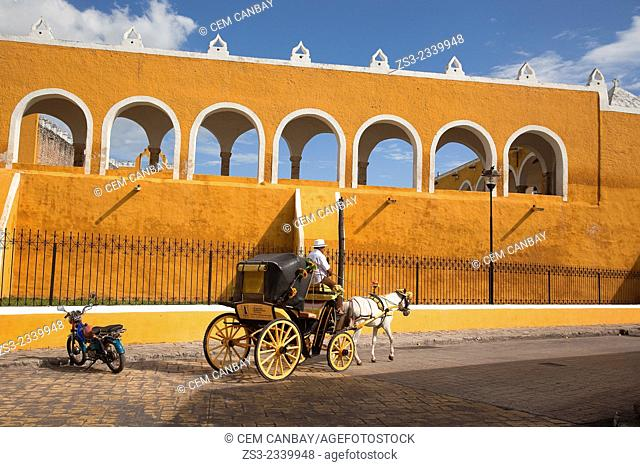 Horse-drawn carriage in front of of the Monastery, Convent Of San Antonio De Padua, Izamal, Yucatan, Yucatan Province, Mexico, Central America