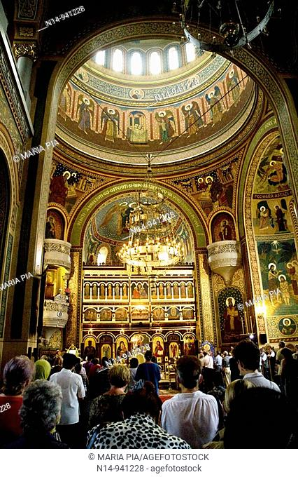 Interior of St. Treime Orthodox church, celebrating mass. Medieval citadel town, Sighisoara, Transylvania, Romania, Europe
