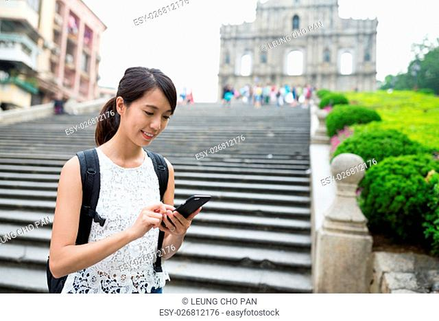Woman using mobile phone in Macao