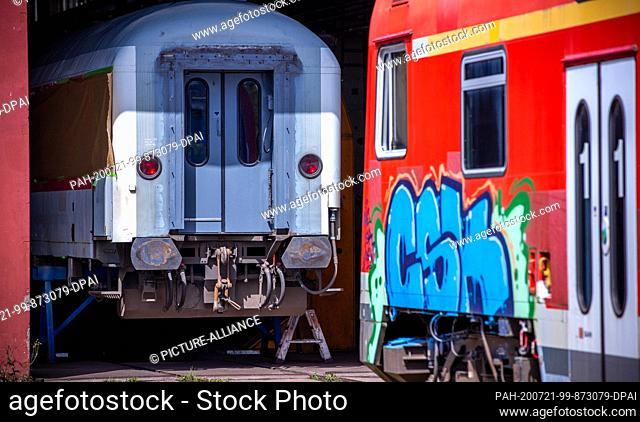 16 July 2020, Mecklenburg-Western Pomerania, Mukran: Old passenger coaches are reconditioned in the repair workshop of Baltic Port Services GmbH (BPS)