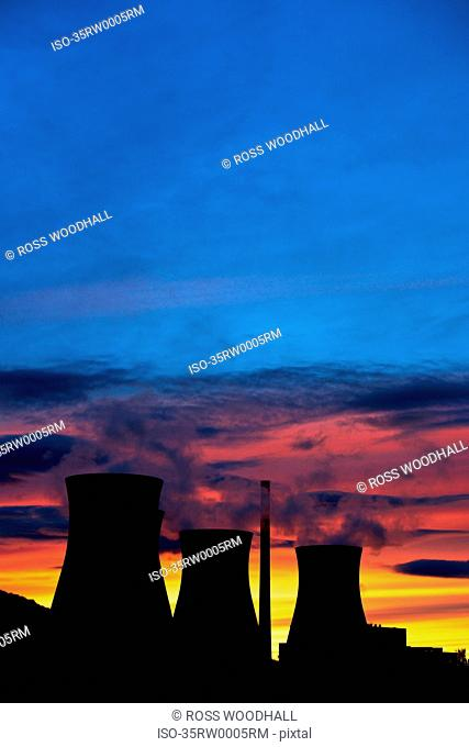 Silhouette of coal plant cooling towers
