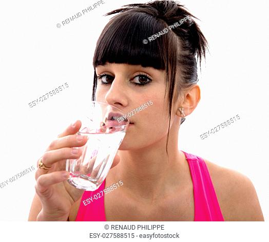 young brunette girl drinks a glass of water, isolated on white background