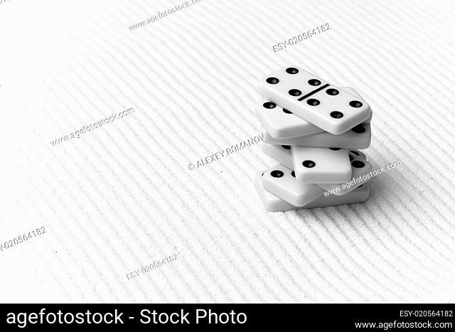 Dominoes against sand