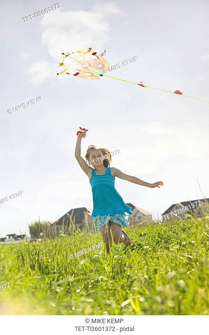 Young girl flying a kite