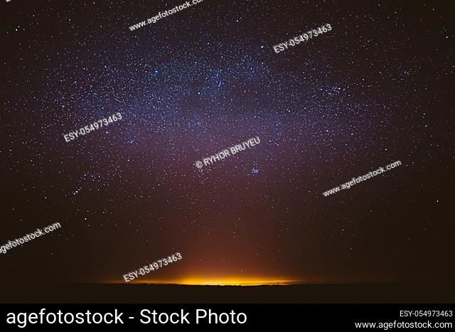 Real Night Sky Stars Background With Natural Colourful Sky Gradient. Sunset, Sunrise Light And Starry Sky. Yellow And Black Colors