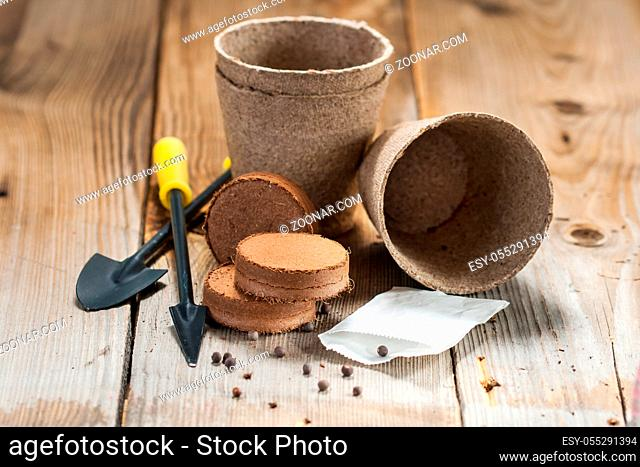 Peat bricks and pots, seeds and garden tools