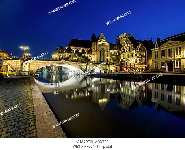 Belgium, Ghent, Korenlei and Graslei with St. Nicholas' Church and St. Michael Bridge at night