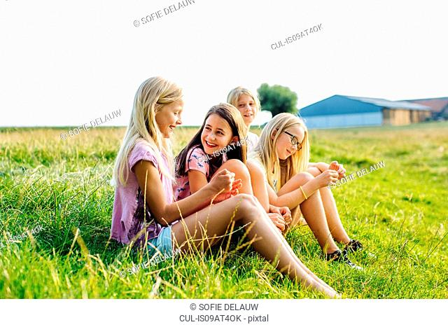 Girls enjoying view in field, Flanders, Belgium